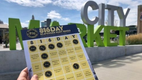 Picture of a bingo card, made specifically for the 816 Day celebration, taken in front of the 'City Market' sign