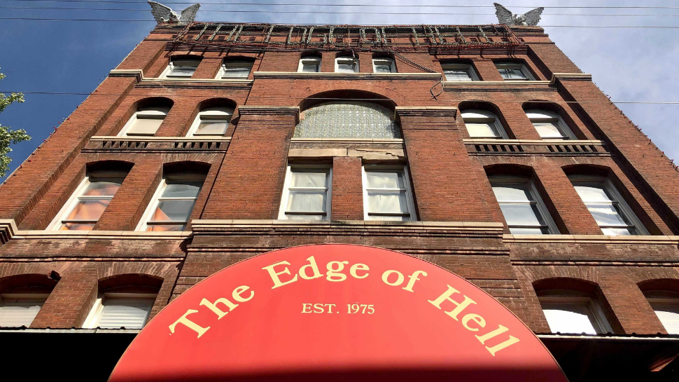 The Edge of Hell stands tall on a clear, sunny day in Kansas City's Historic West Bottoms.